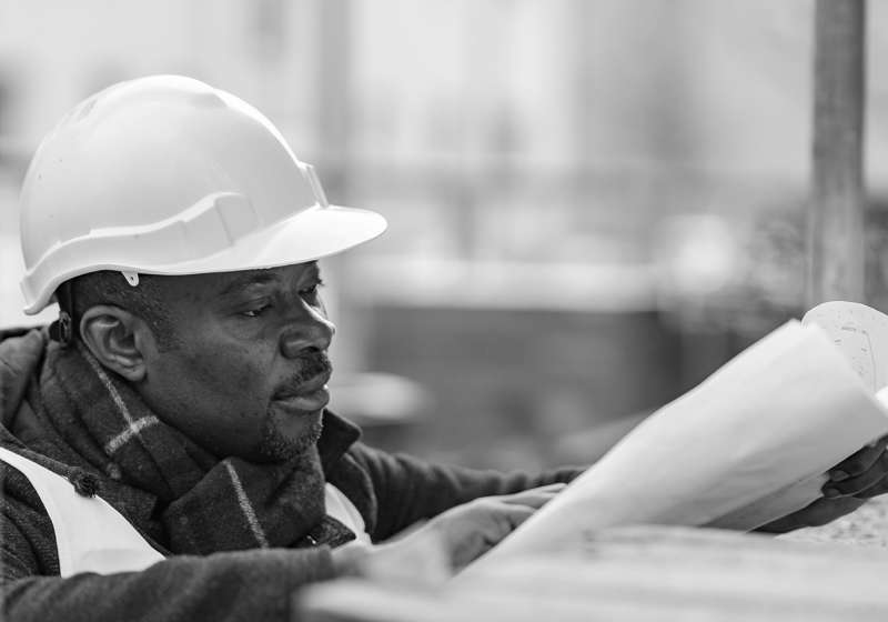 Profile portrait of an absorbed African American male engineer w